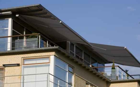Millennium folding arm awning, - Ozsun Shade Systems