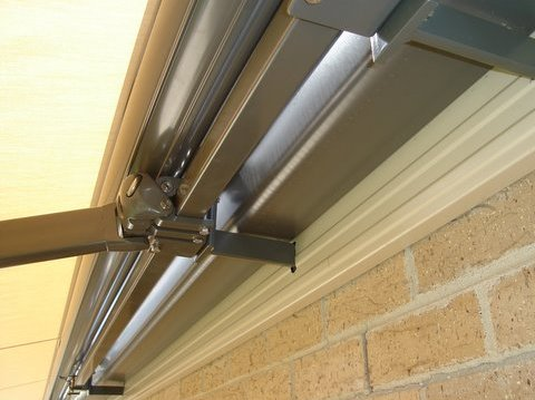 folding arm awning fitted on fascia brackets